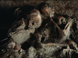 A Close View of Embracing Skeletons Excavated on Herculaneums Beach Photographic Print by O. Louis Mazzatenta