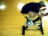 Man on Stationary Bicycle Photographic Print