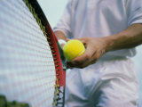 Man Holding a Tennis Ball And a Tennis Racket Photographic Print