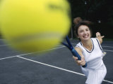 Close-up of a Young Woman Playing Tennis Photographic Print