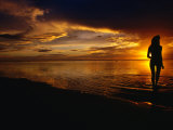 Woman on Beach at Sunset, Cook Islands Photographic Print by Peter Hendrie
