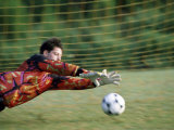 Goalie Diving on a Field To Save The Ball Photographic Print