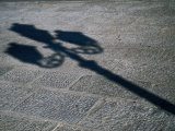 Lamp-Post Shadow Near Harbour of Porta a Mare, Alghero, Sardinia, Italy Photographic Print by Martin Lladó
