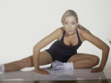 Woman Stretching Before Exercise Photographic Print