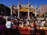 Crowds of People Giving Offerings in Grounds of Wong Tai Sin Temple, Kowloon, Hong Kong Photographic Print by Richard I'Anson