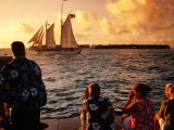 People Looking at Harbour from Mallory Square at Sunset, Key West, USA Photographic Print by Witold Skrypczak
