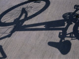 Shadow of a Bicycle Photographic Print