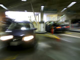 Blurred Image of Cars in a Parking Garage Photographic Print