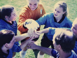 High Angle View of a Girl's Soccer Team in a Huddle Photographic Print