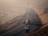 Traffic on Route 16 Above the City, Iquigue, Tarapaca, Chile Photographic Print by Paul Kennedy
