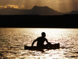 Njemp Fisherman Paddling on Lake at Sunset, Lake Baringo, Kenya Photographic Print by Anders Blomqvist