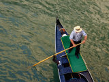 A Gondolier Steers His Craft Through a Canal, Venice, Veneto, Italy Photographic Print by Glenn Beanland