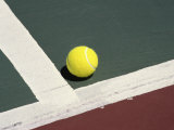 Tennis Ball on a Court Photographic Print