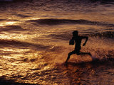 Boy Playing Ball on Galle Beach at Sunset, Colombo, Sri Lanka Photographic Print by Richard I'Anson