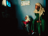 Muslim Girls Relax Watching Television, Indonesia Photographic Print by Adams Gregory
