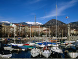 Yachts in Harbour at Intra with Old Town and Mountains in Background, Lago Maggiore, Italy Photographic Print by Martin Moos