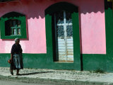 Elderly Woman Walking Past Pink and Green Building, Chiapas, Mexico Photographic Print by Eric Wheater