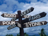Sign Showing Directions to Other Cities in World, Koumac, New Caledonia Photographic Print by Jean-Bernard Carillet