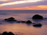 Twilight View of Rock and Surf Photographic Print by Raymond Gehman