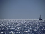 A Lone Sailboat on the Horizon in Shark Bay Photographic Print by Jason Edwards