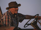 A Man Driving a Truck Photographic Print by Medford Taylor