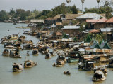 Houseboats Dot a Canal in Bangkok Photographic Print by W. Robert Moore