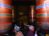 Pilgrims Turning Giant Prayer Wheels in the National Chorten of Thimphu, Thimphu, Bhutan Photographic Print by Izzet Keribar