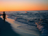Woman Walking on the Beach Into the Sunset, FL Photographic Print by Ken Glaser