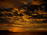 The Clouds Create a Gorgeous Pattern Due to the Setting Sun Photographic Print by Tim Laman