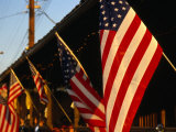 Flags Hanging Outside Diner, Texas, USA Photographic Print by Dallas Stribley
