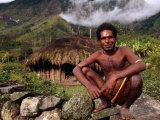 Dani Man in Front of His House Near the Baliem Gorge, Tangma, Irian Jaya, Indonesia Photographic Print by Karl Lehmann