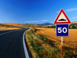 Speed Sign on Winding Road Near San Quirico d'Orica, Tuscany, Italy Photographic Print by David Tomlinson