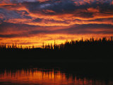 Sunset is Reflected in the Mackenzie River Photographic Print by Raymond Gehman