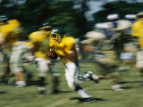 High School Football Player Carrying the Ball Photographic Print by Brian Gordon Green