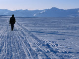 Local Walking Through Arctic Landscape Carrying Gun for Protection., Svalbard Photographic Print by Christian Aslund