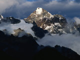 Snow-Capped Mountain Peak in Sunlight and Clouds, Peru Photographic Print by Richard I'Anson