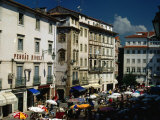 Market and Buildings in City Street, Coimbra, Portugal Photographic Print by Bethune Carmichael