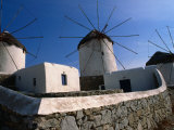 Thatched-Roof Windmills on Plateau, Mykonos Town, Greece Photographic Print by Wayne Walton