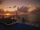 Sunset and Jet Skis, Cancun, Mexico Photographic Print by Walter Bibikow