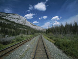 Train Tracks Winding Their Way Through the Canadian Rockies Fotoprint van Todd Gipstein