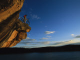 A Cyclist Atop a Rock Overhang Near Dolores, Colorado Fotoprint van Bill Hatcher