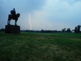 The Stonewall Jackson Statue Looks Towards a Bolt of Lightning Photographic Print by Sam Abell