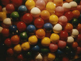 A Colorful Close View of Gumballs Behind Glass Photographic Print by Stephen St. John