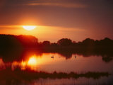 Sunset over Black Duck Pond Photographic Print by Al Petteway
