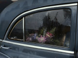 A Floral Arrangement Seen Through the Rain-Spattered Window of a Car Photographic Print by Sam Abell