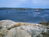 A Lobster Boat Sits at Anchor in a Bay in Maine on an Autumn Day Photographic Print by Taylor S. Kennedy