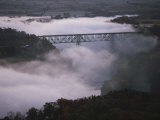 A Railroad Bridge Crosses a Fog-Bound River Photographic Print by Sam Abell