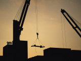 Silhouette of Cranes and Workers at the Port of Antofagasta Photographic Print by Joel Sartore