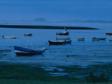 Small Fishing Boats Line the Shore at the North End of Lindisfarne Photographic Print by Sisse Brimberg