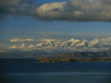A view of Lake Titicaca across to the snow-capped Andes Mountains, Photographic Print